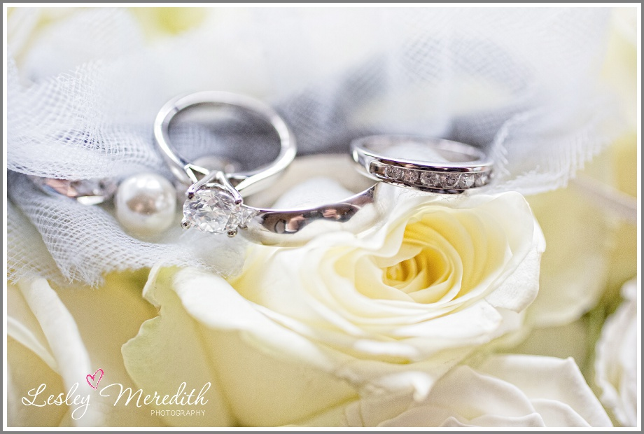 wedding rings on yellow rose at Peckforton Castle