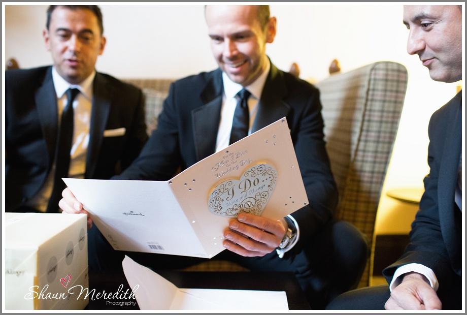 Marcus reading his wedding card.