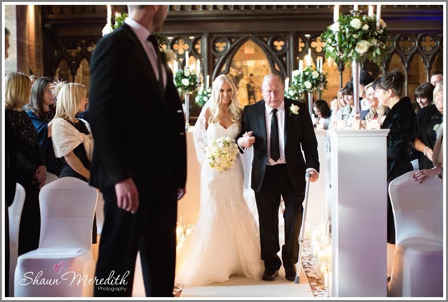 Julie walking down the aisle in Pronovias wedding dress.