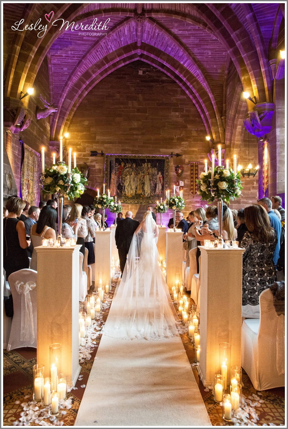 Wedding veil glides down the aisle at Peckforton Castle