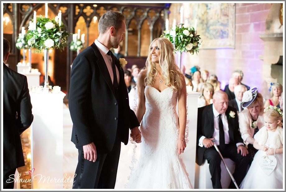 Groom greets his bride at Peckforton Castle
