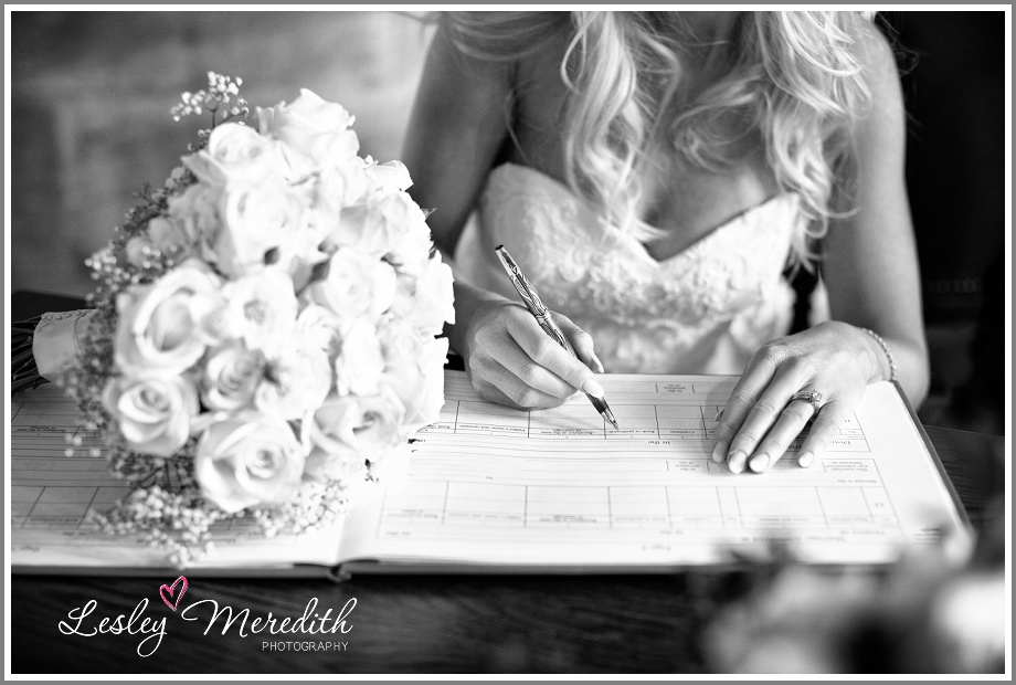 Bridal bouquet on marriage register at Peckforton Castle