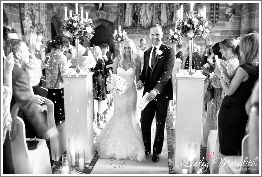 Julie and Marcus walk down the aisle at Peckforton Castle