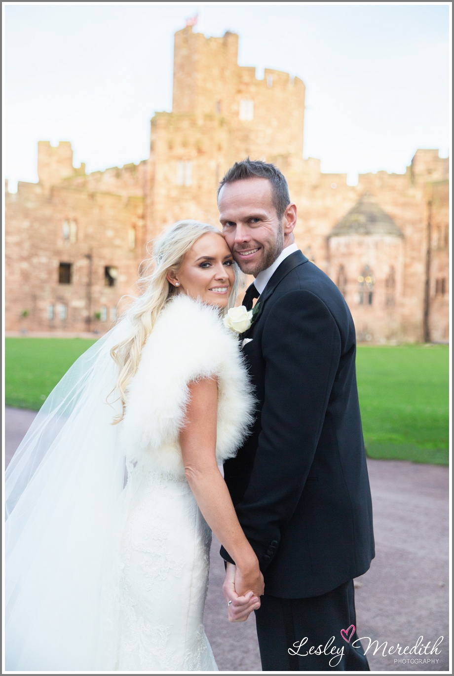 Julie and Marcus with Peckforton Castle in the background