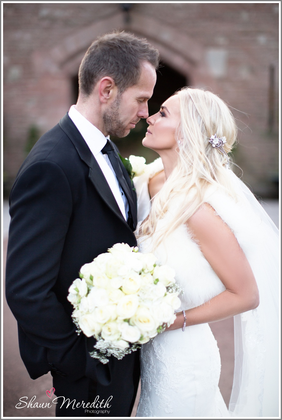Julie and Marcus at the entrance of Peckforton Castle