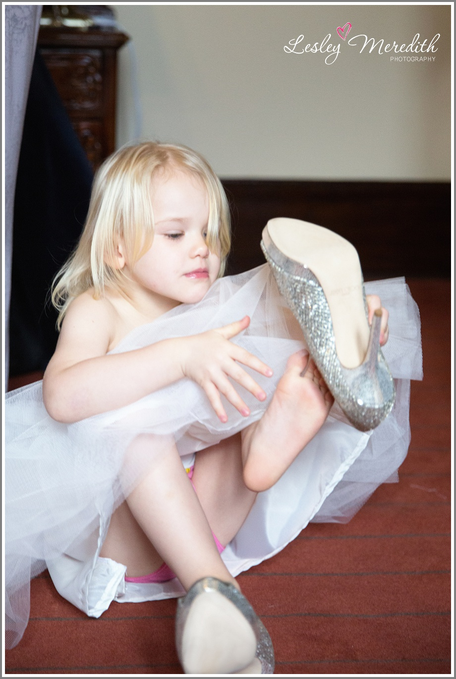 Flower girl trying on bridal shoes