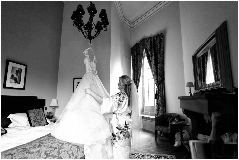 bride looking at dress