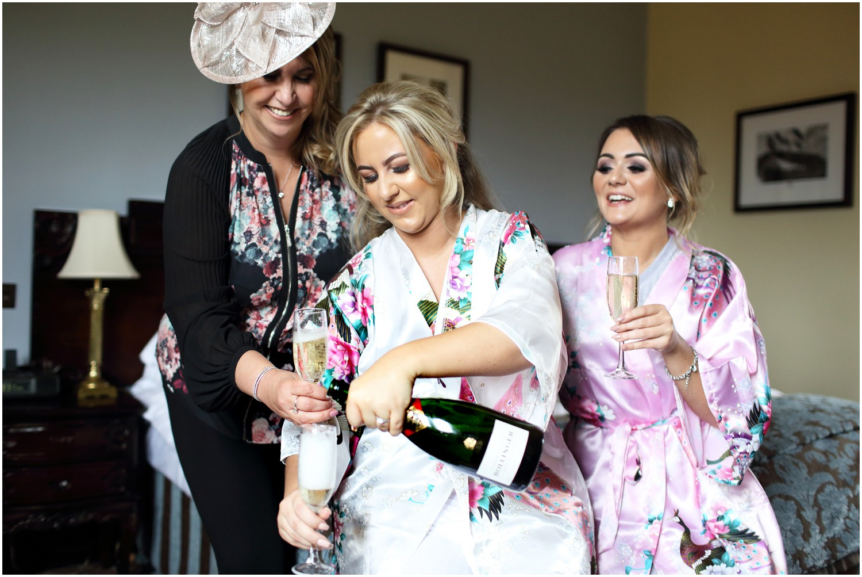 bride pouring champagne