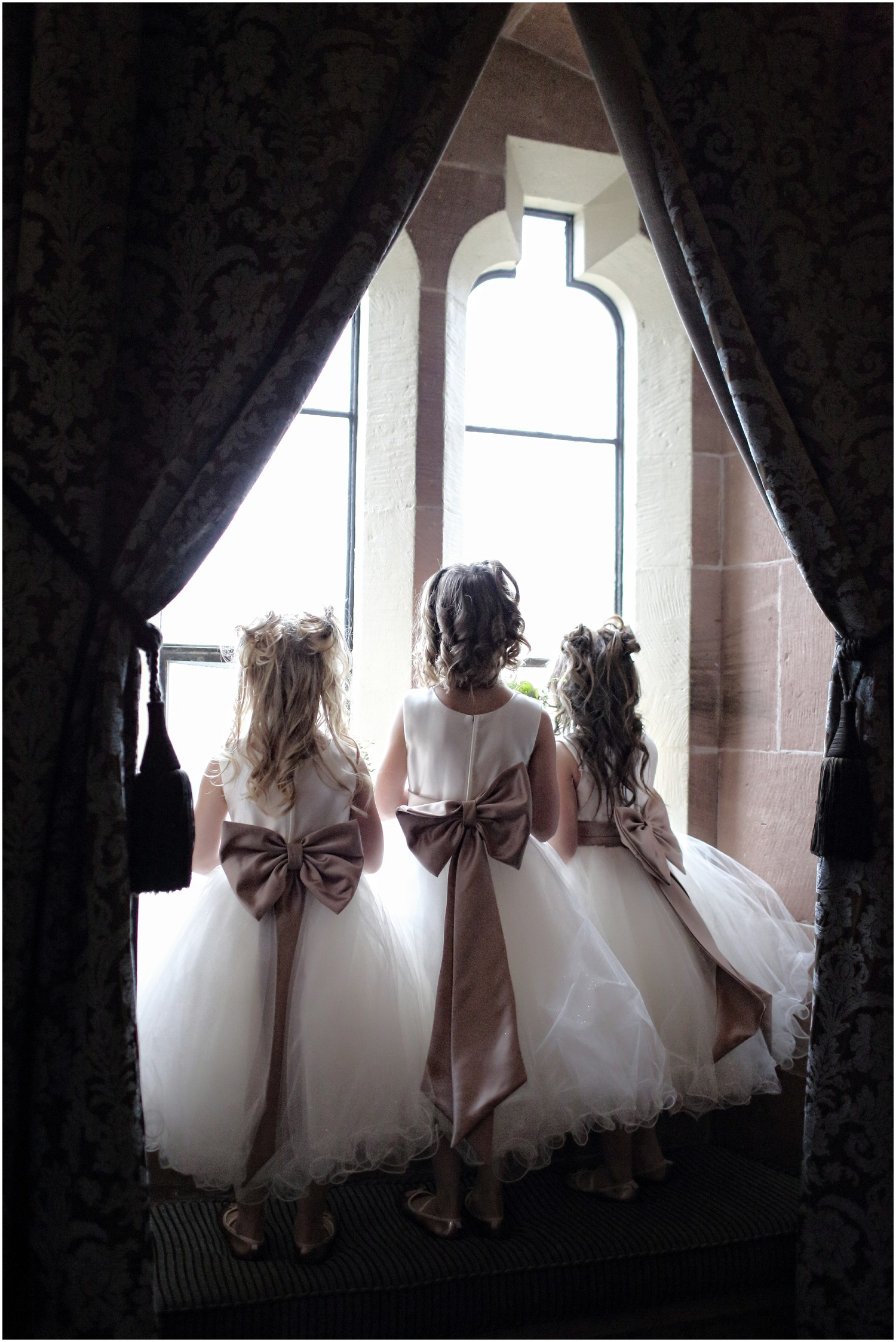 flower girls looking out of window