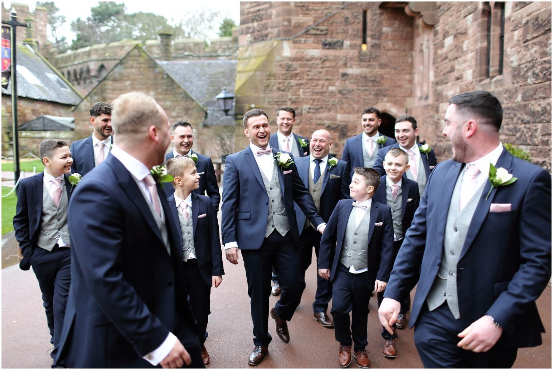 groom walking with guys