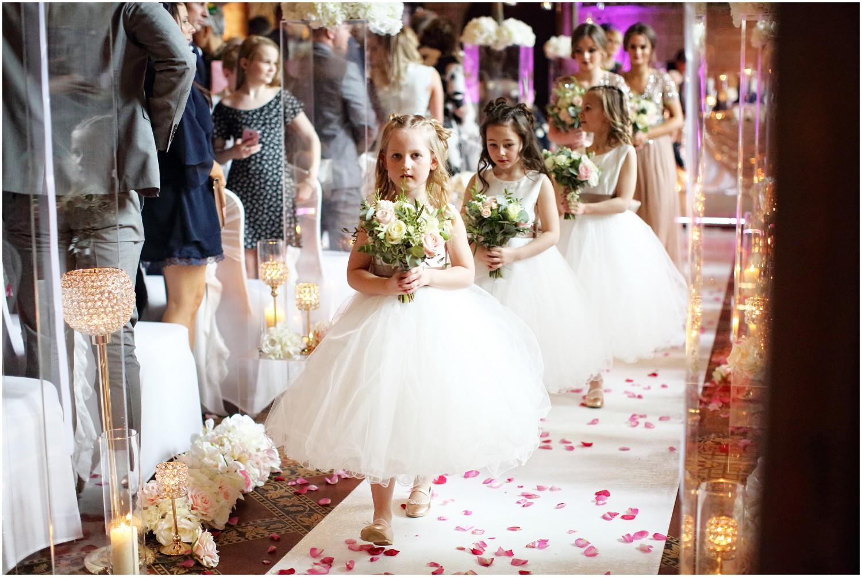flower girls walking down aisle