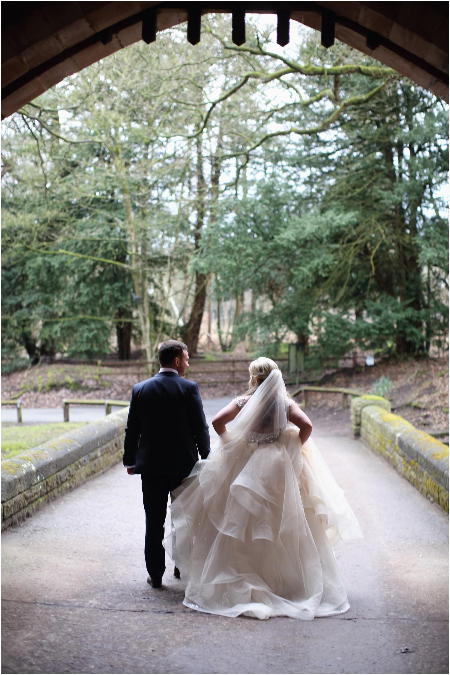 bride and groom from behind walking