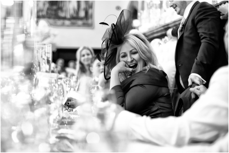 mum of bride laughing during speeches