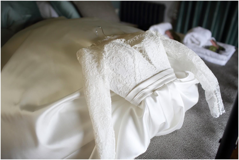wedding dress on bed