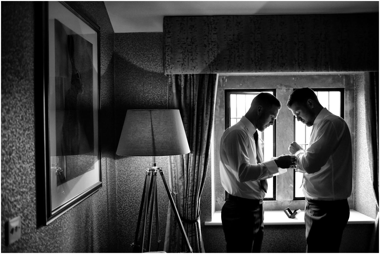 batsman helping groom dressing