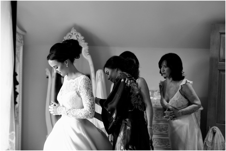 bride getting into wedding dress