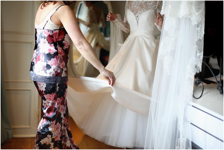 final touches to wedding dress