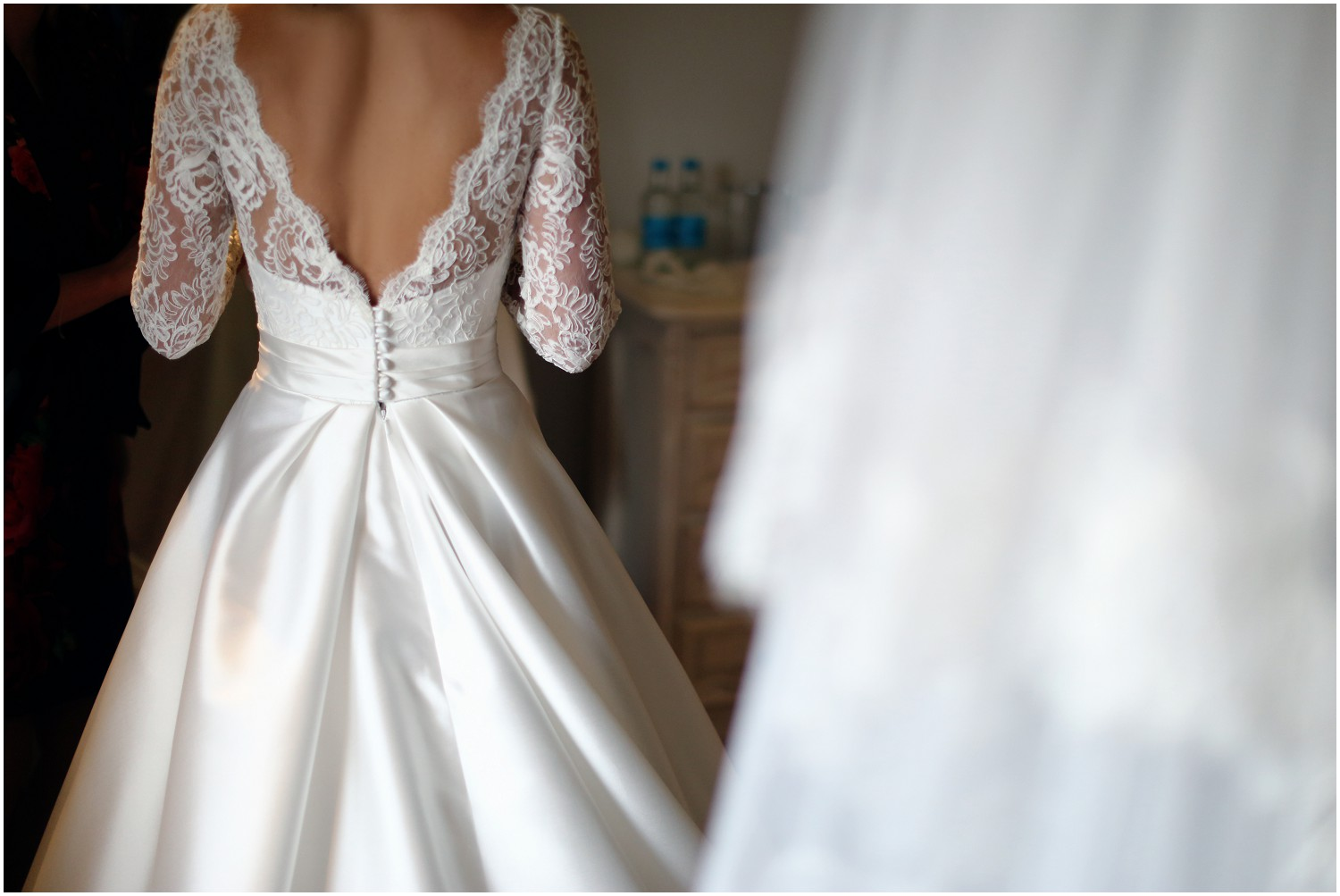 lace and button detail Suzanne neville wedding dress
