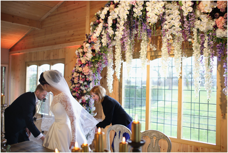 flower canopy signing wedding register