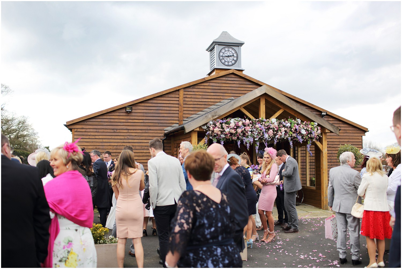 guests outside wedding chapel