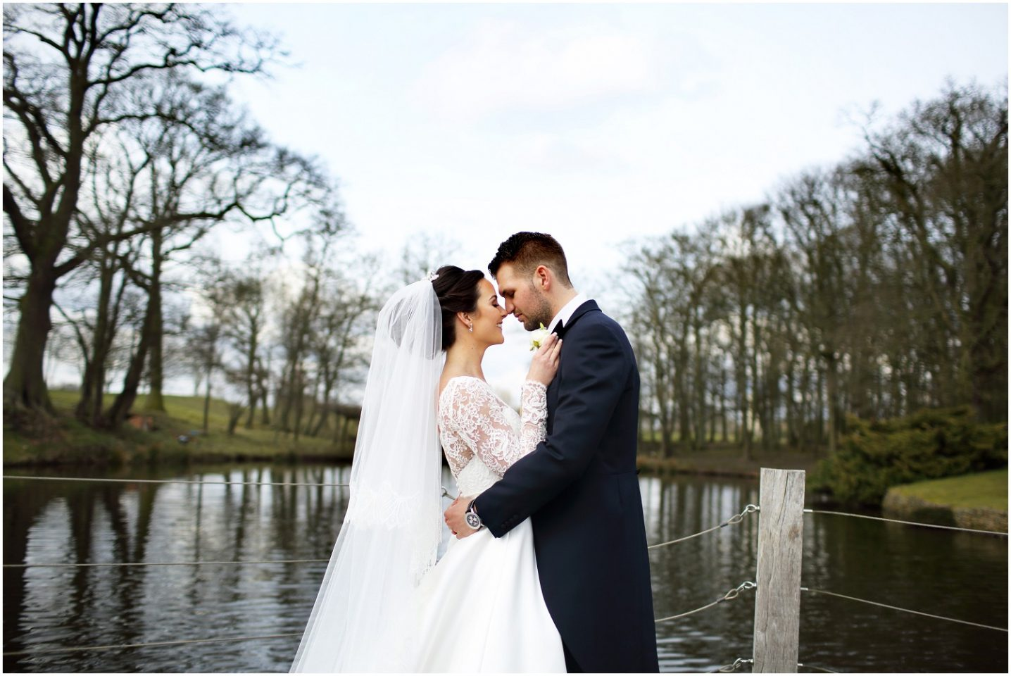 bride and groom by lake at Merrydale manor