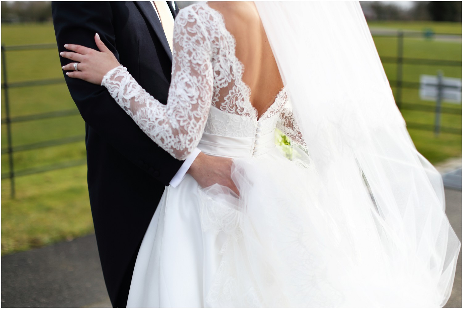 close shot of bride and grooms hands