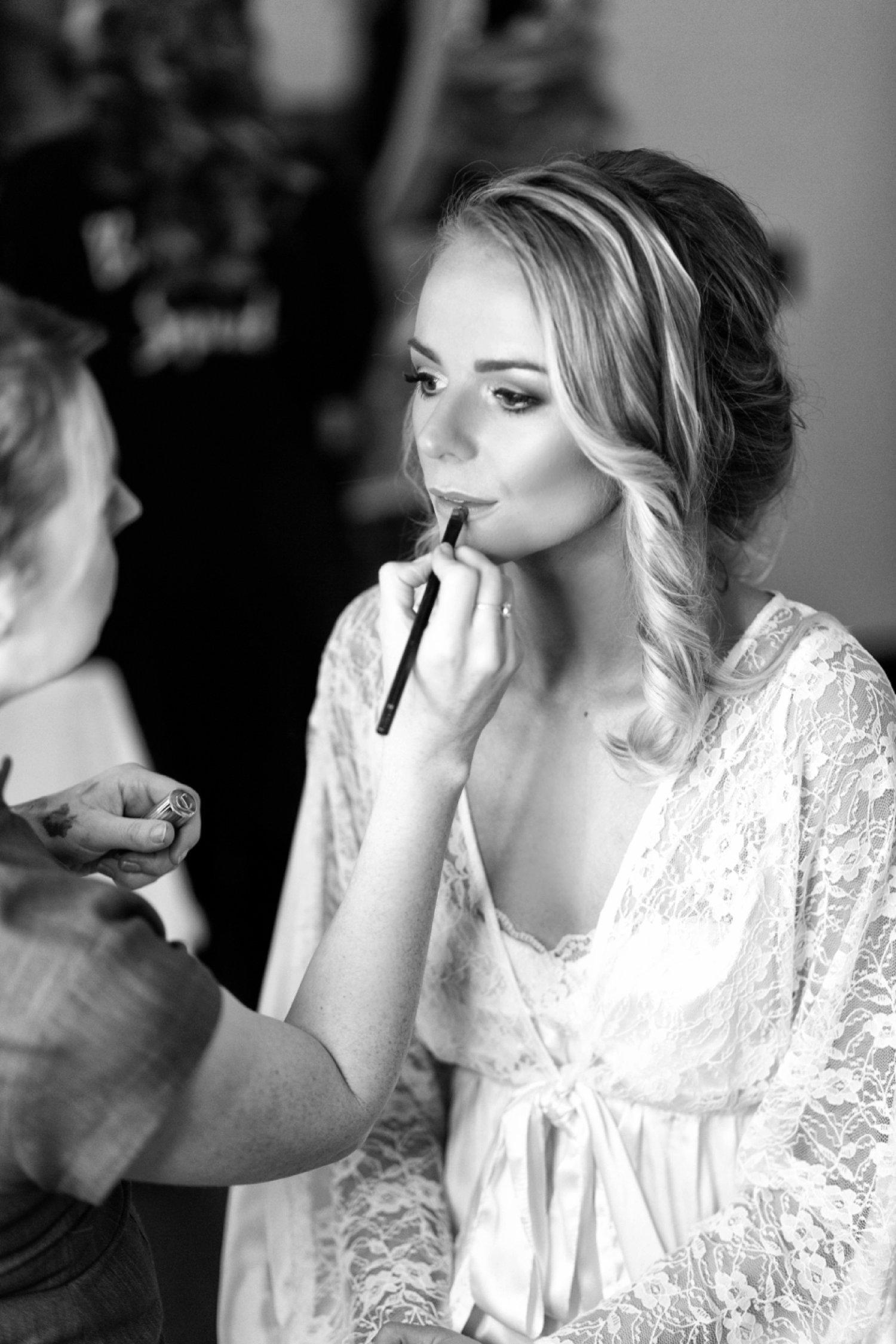 bride having lipstick on