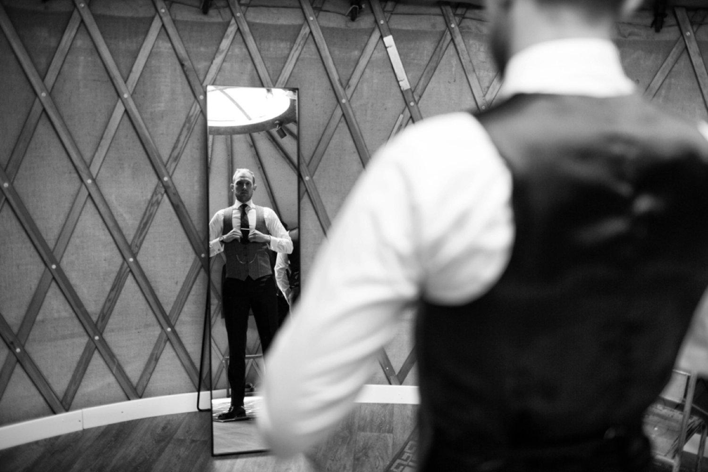 groom fixing tie