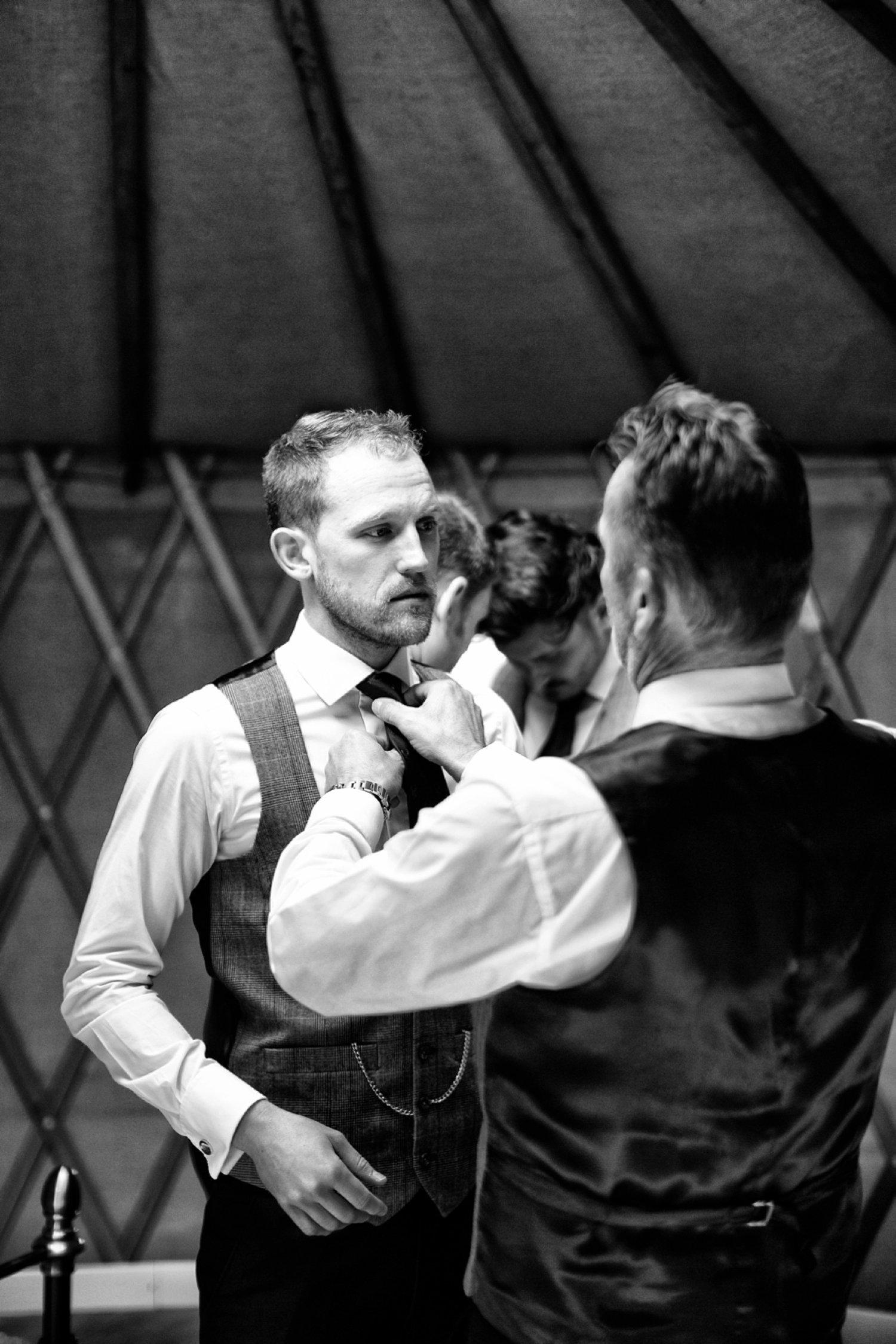bestman fixing tie