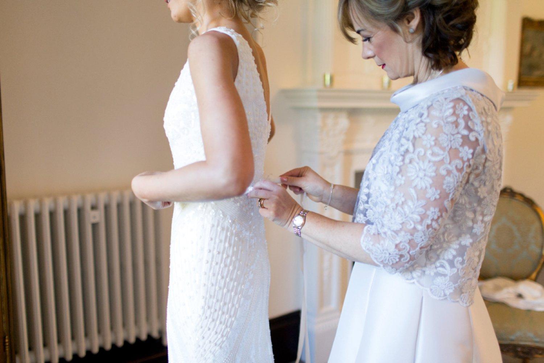 mum dressing bride