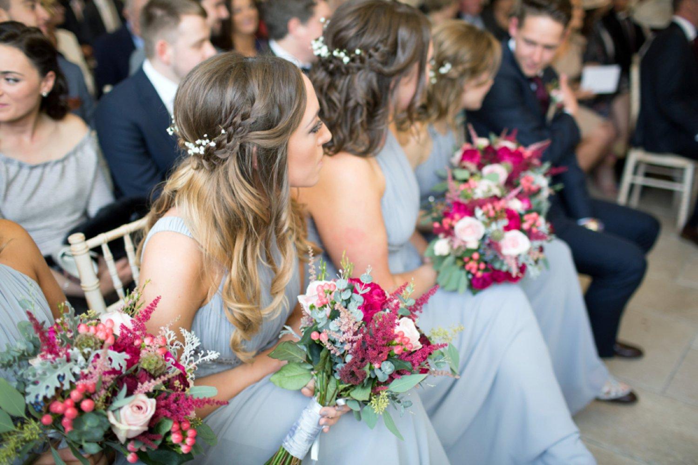 bridesmaids watching wedding