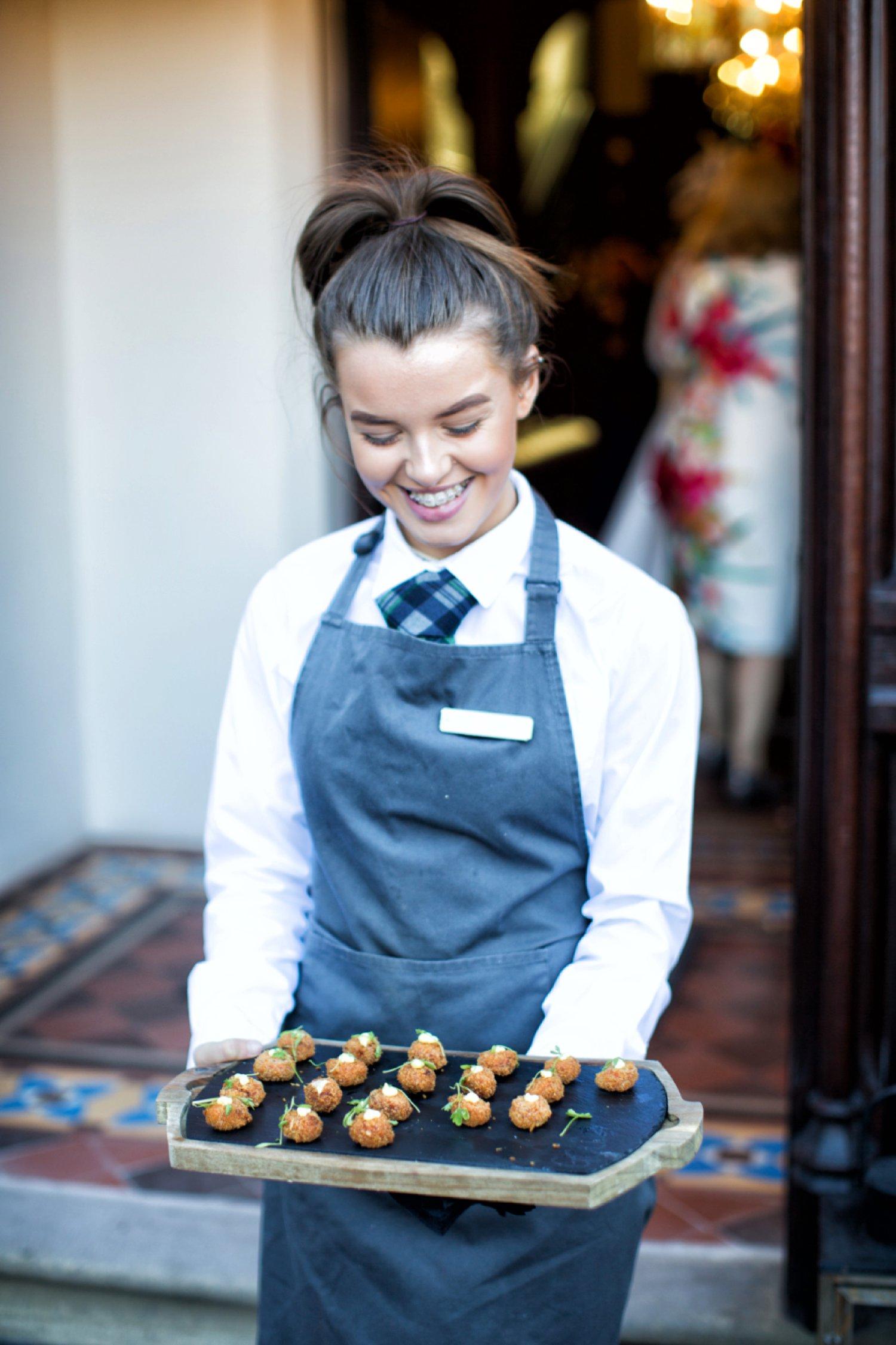 staff serving canapés