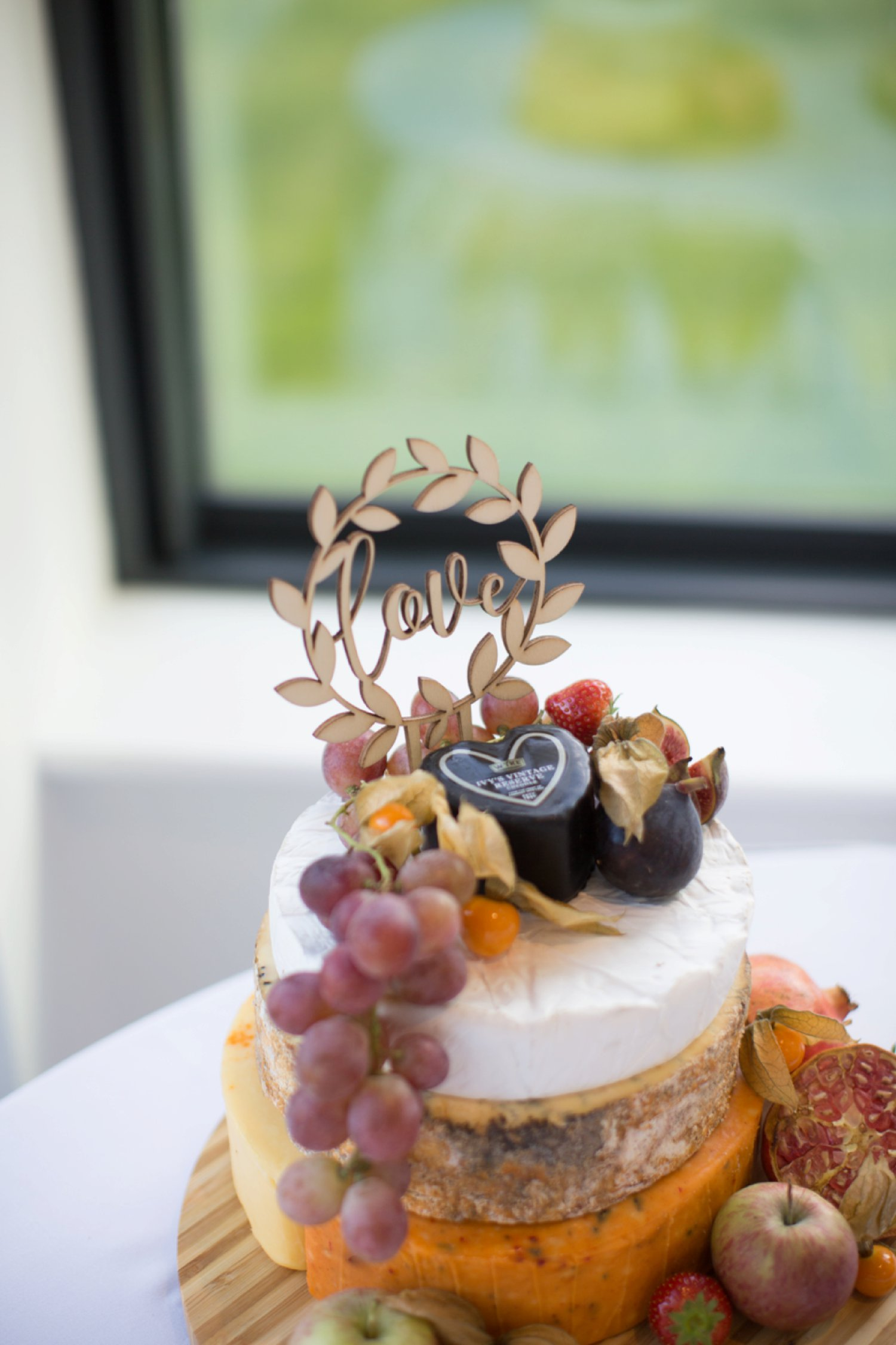 cheese wedding cake with topper