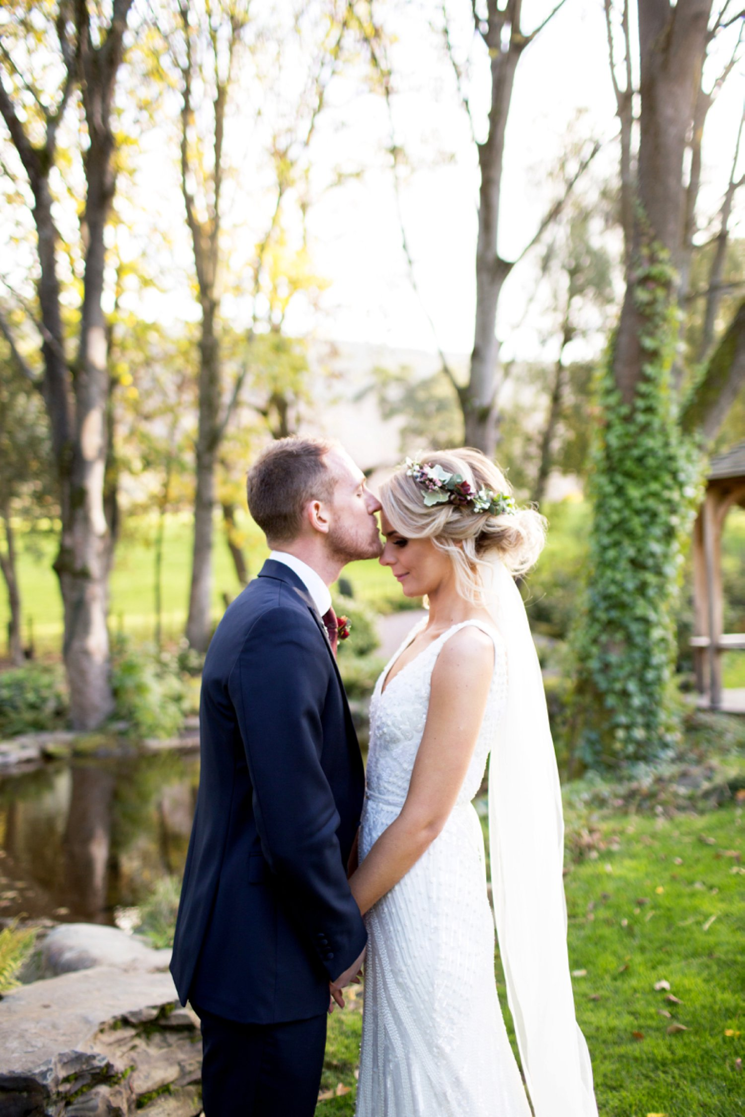 groom kissing brides head