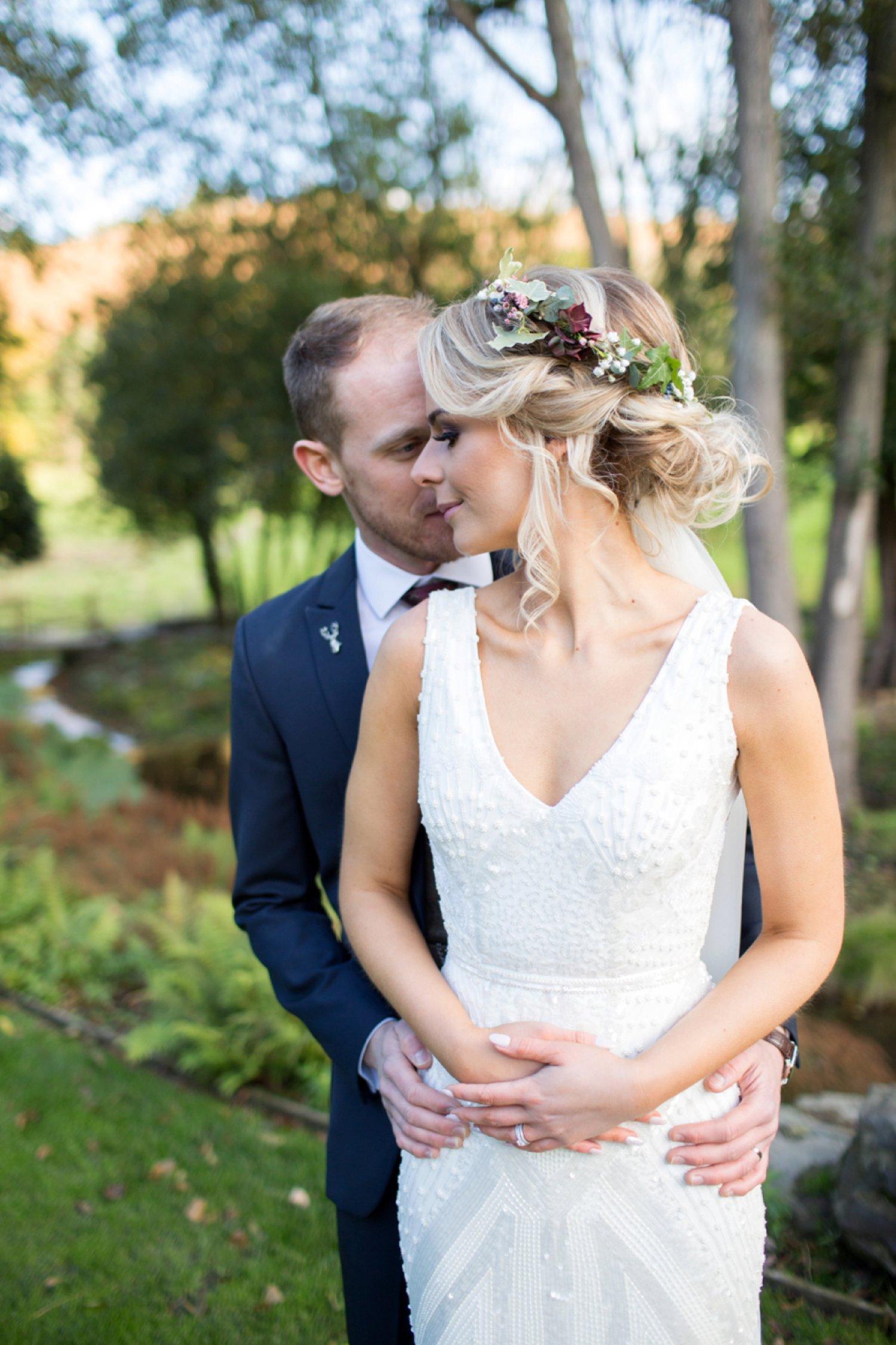 bride and groom cuddle