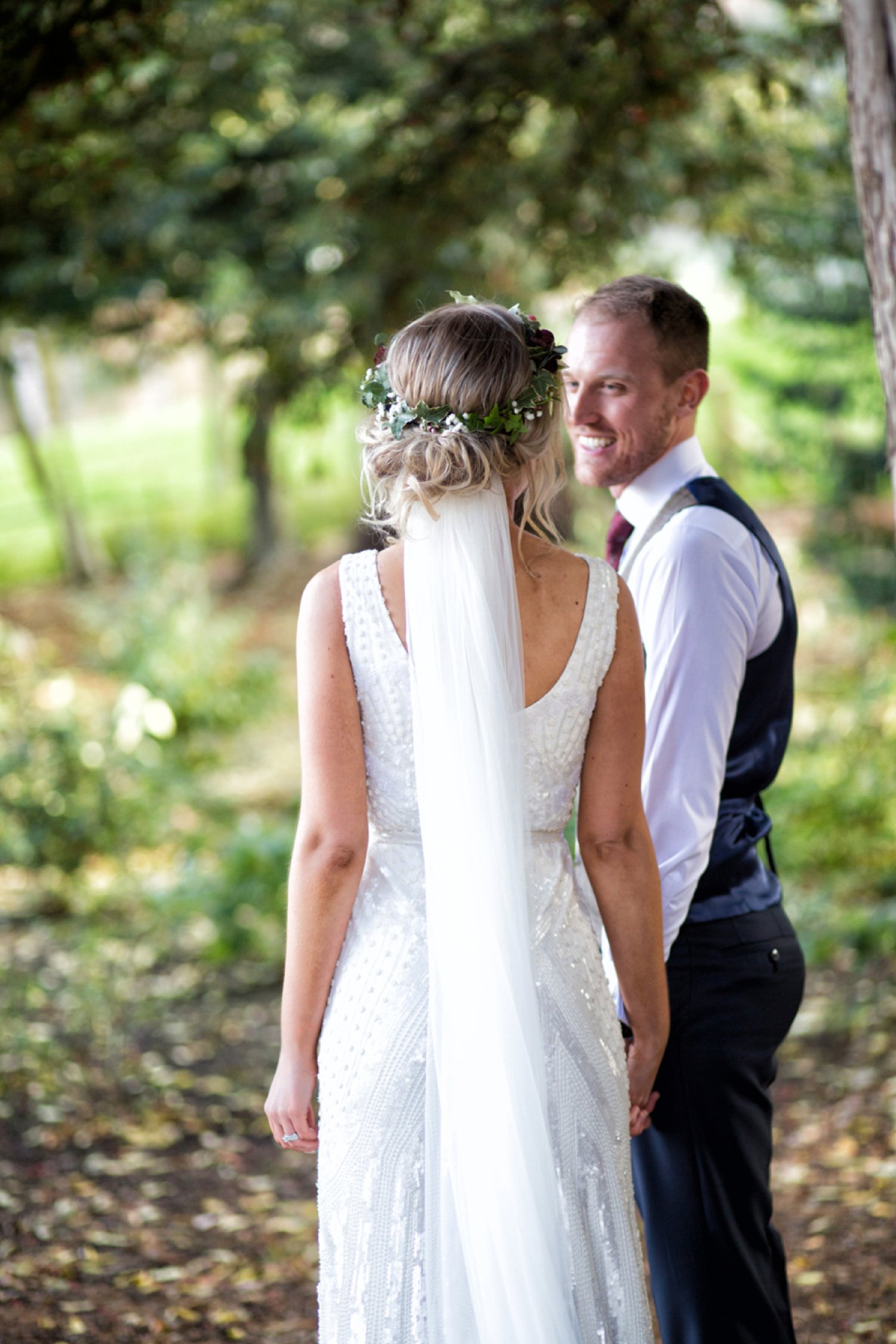 back of bride flower crown and dress