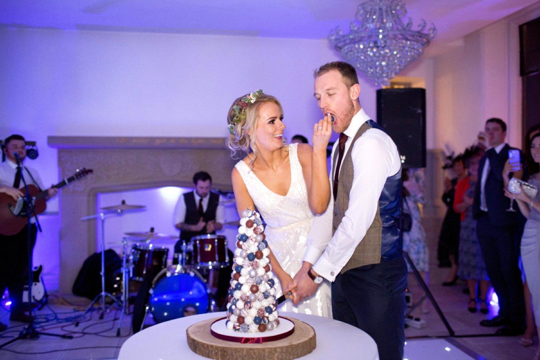 bride feeding groom wedding cake