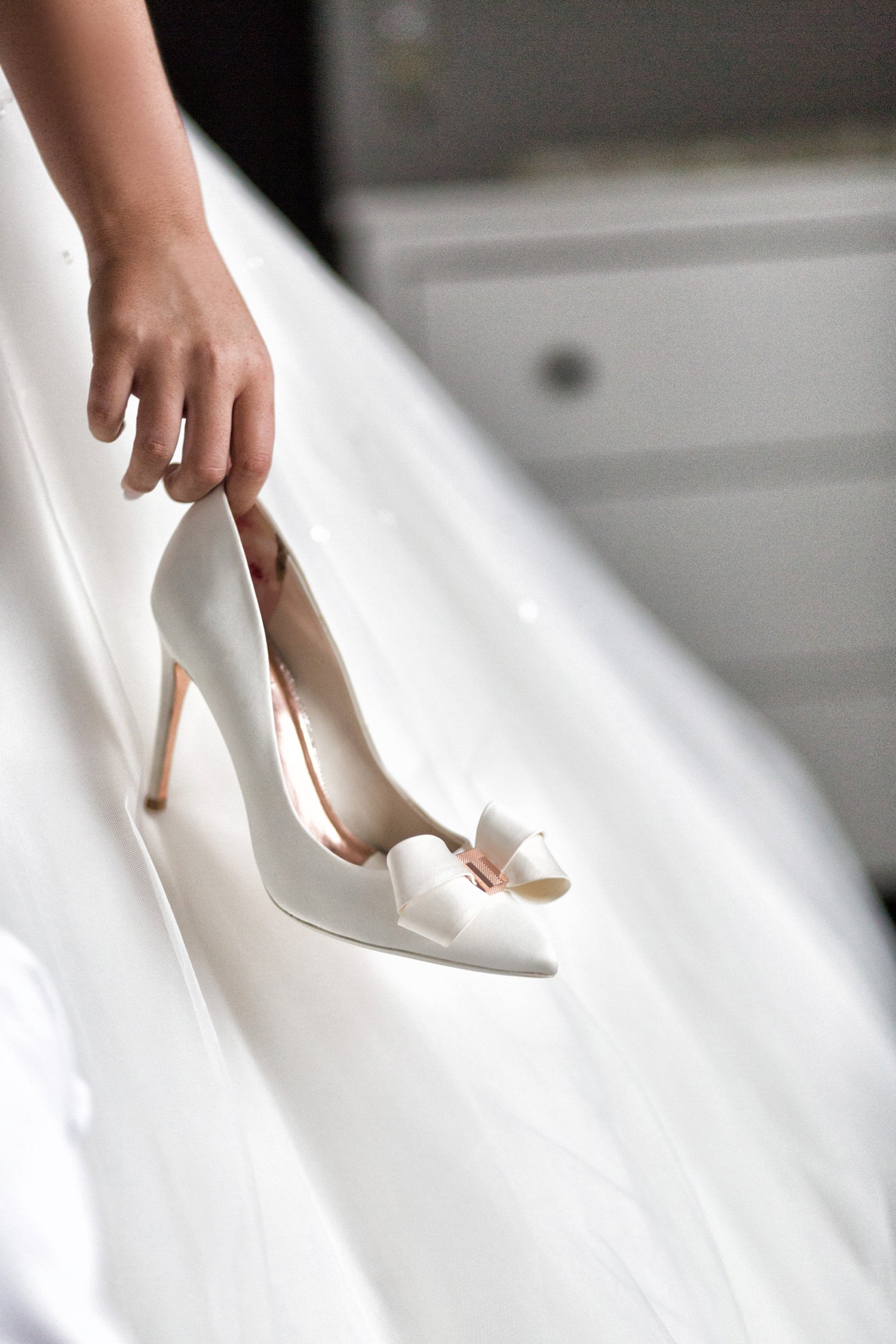 bride holding ted baker shoe